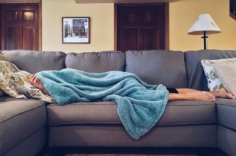 woman self isolating sick at home