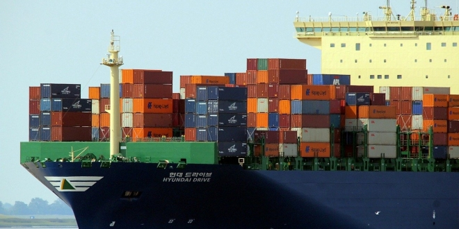 Shipping containers on boat in port