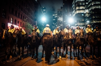 police at protest on horses